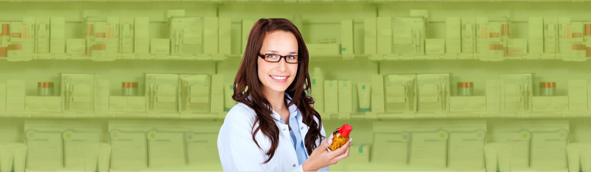 female pharmacist holding a medicine bottle
